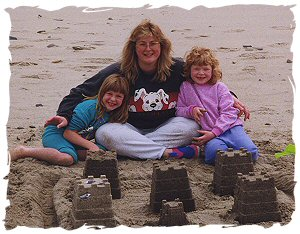 Cyndi and her girls building a sand castle