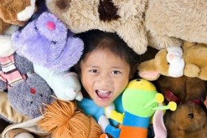 Girl Playing in Stuffed Animals